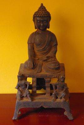 Chinese Bodhisattva in metal on his altar