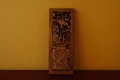 Old wooden panel carved from China vase